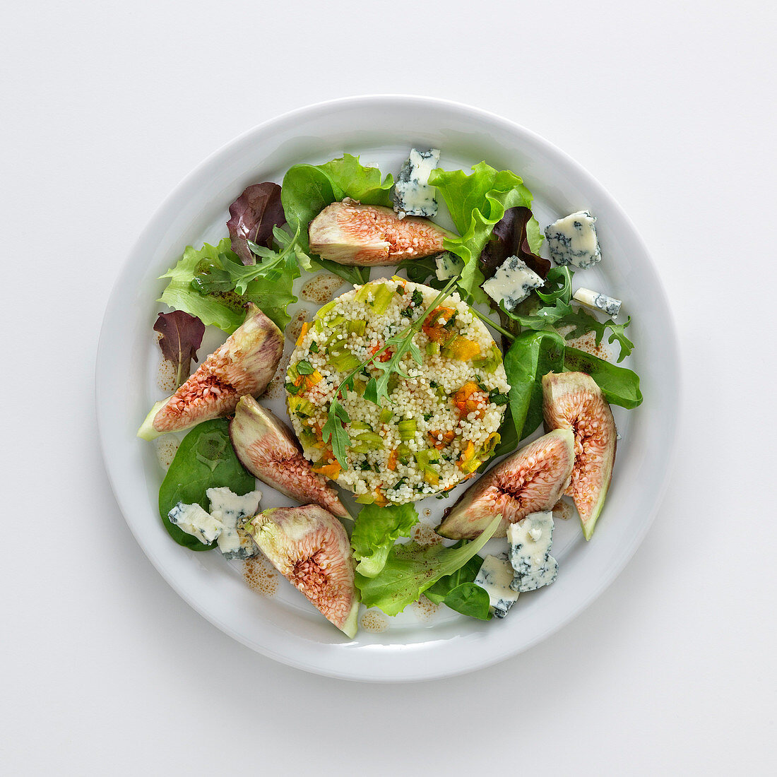Couscous with zucchini blossoms, figs, gorgonzola and salad
