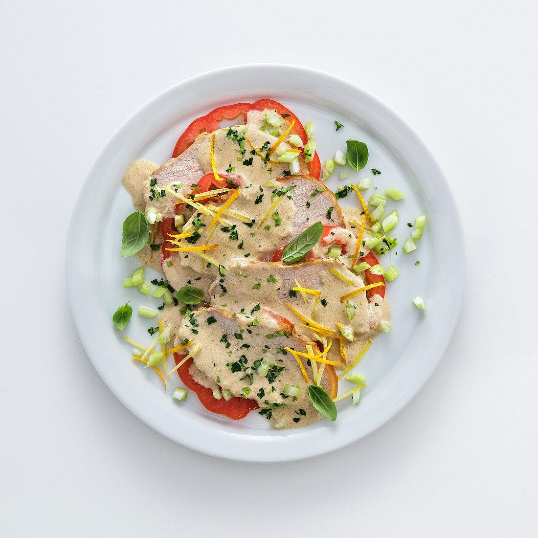 Roast veal with tuna fish sauce on beefsteak tomatoes