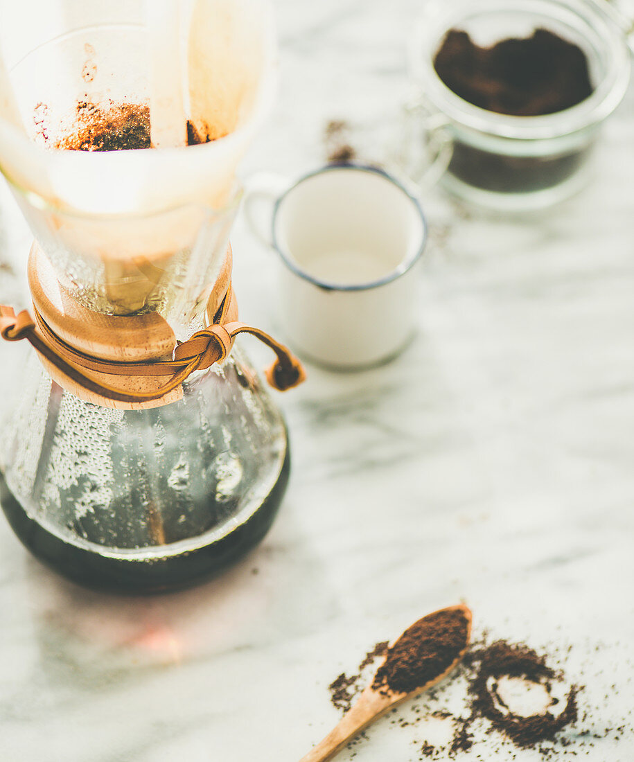 Alternative coffee brewing concept - Morning black filtered coffee in Chemex and white cup