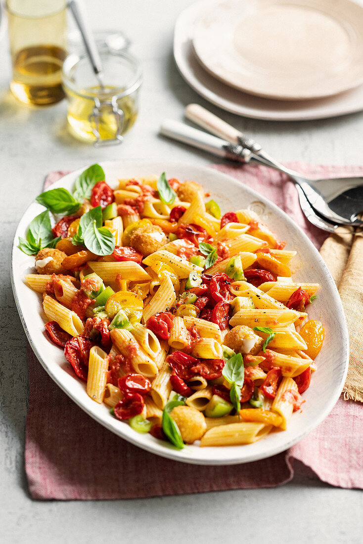 Pasta with various coloured tomatoes and fried mini mozzarella
