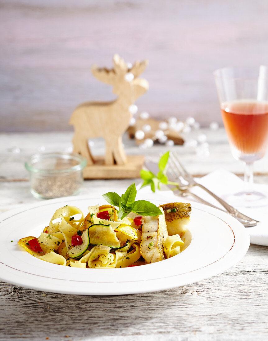Zander fillet on zucchini and paprika tagliatelle