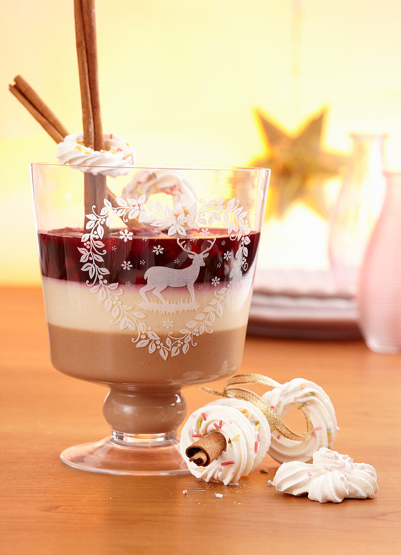 Marzipan and nougat cream with berry compote, meringue rings and cinnamon sticks