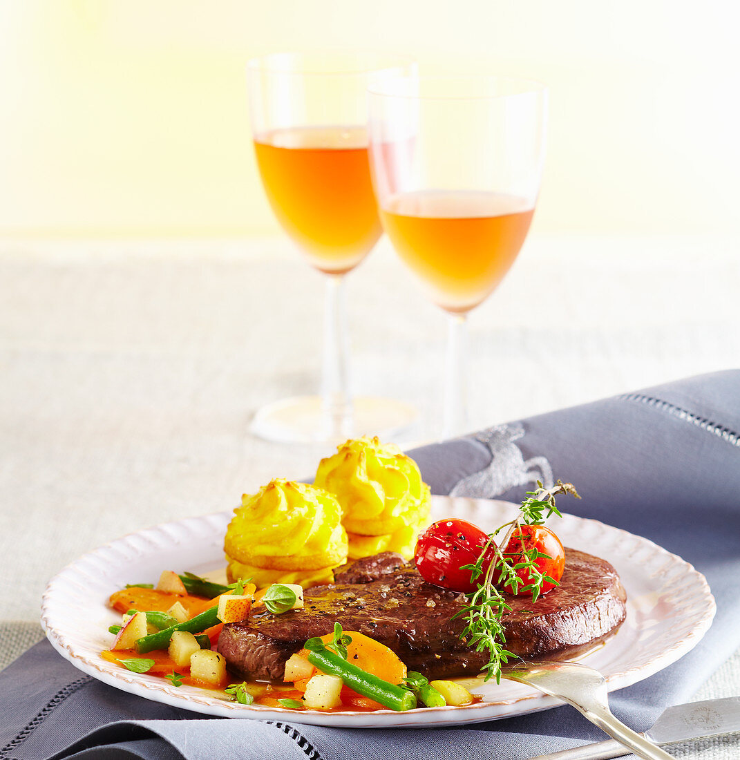 Venison steaks with potato towers, a bean medley and preserved pears
