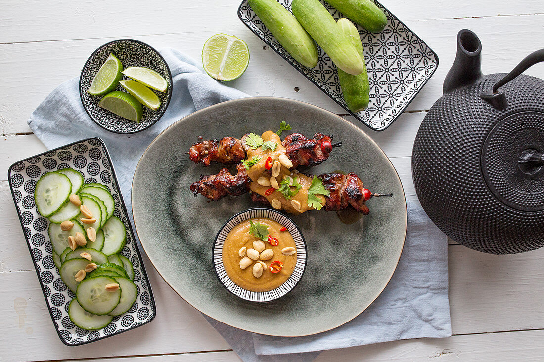 Pork satay with peanut sauce and Asian cucumber salad