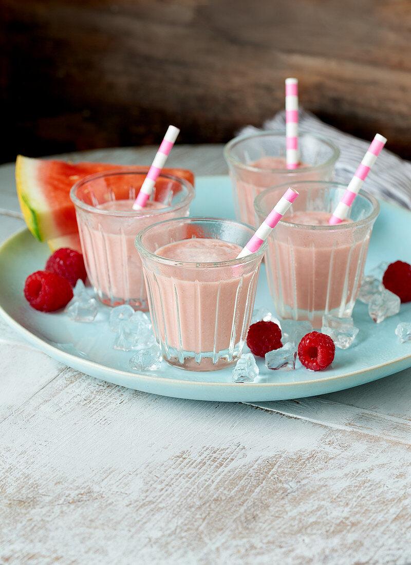 Raspberry smoothies with watermelon and vanilla ice cream