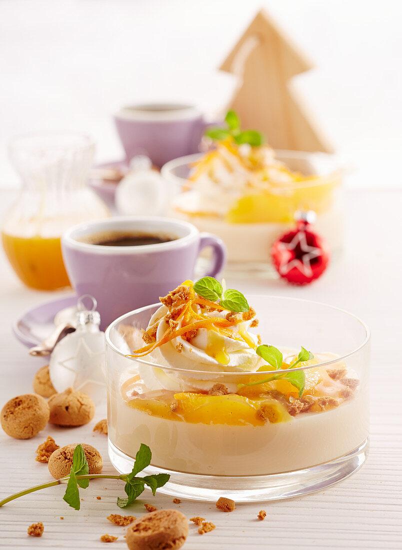 Caramel blancmange with orange sauce, whipped cream and amarettini
