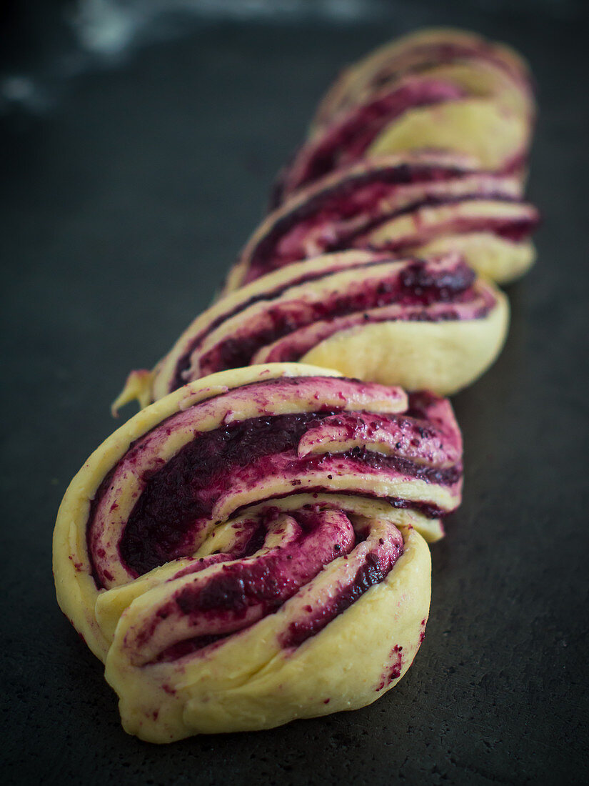 Unbaked blueberry yeast dough plait