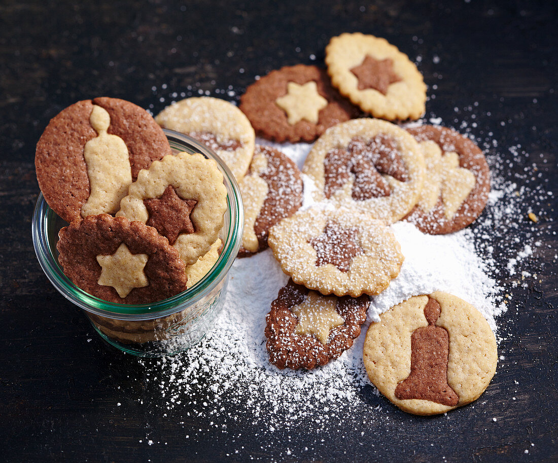 Black-and-white biscuits with icing sugar for Christmas