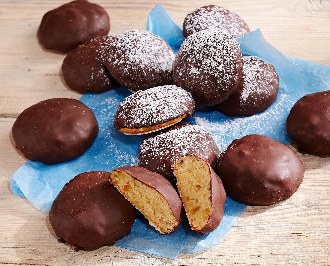 Zurich Christmas cakes with wafer bases, orange zest, marzipan, chocolate glaze
