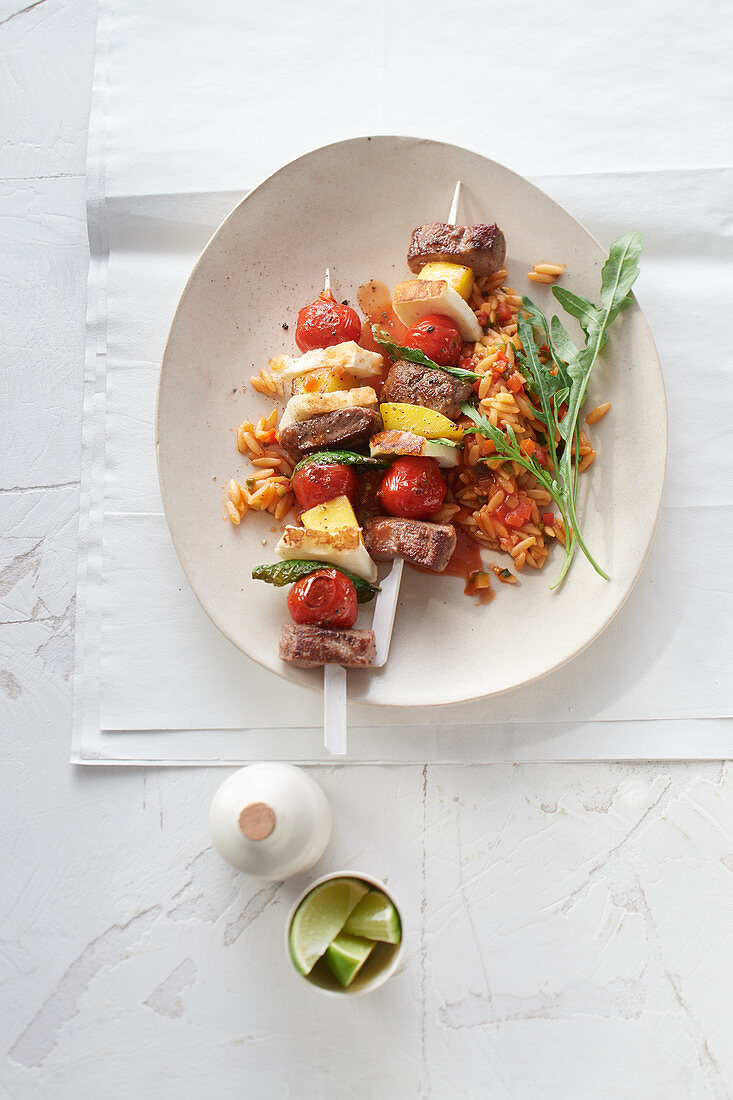 Spicy halloumi and lamb kebabs with Greek rice noodles