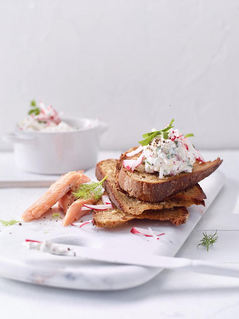 Rye bruschetta with cream cheese, radish cream and char