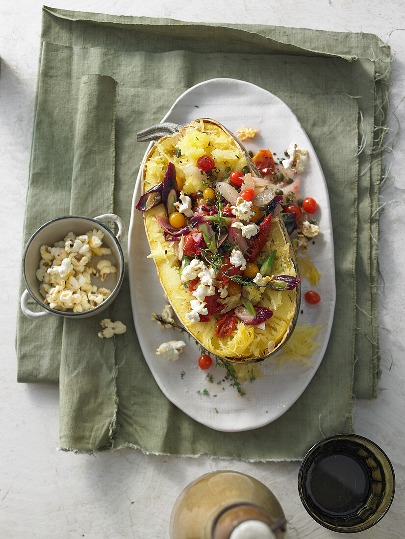 Warm spaghetti squash salad with fried leek, cherry tomatoes, capers and chilli popcorn