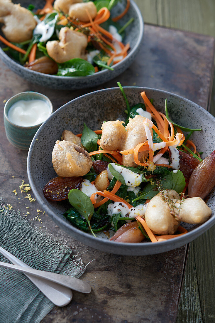 Battered porcini mushrooms on spinach salad with carrot spaghetti and marsala shallots