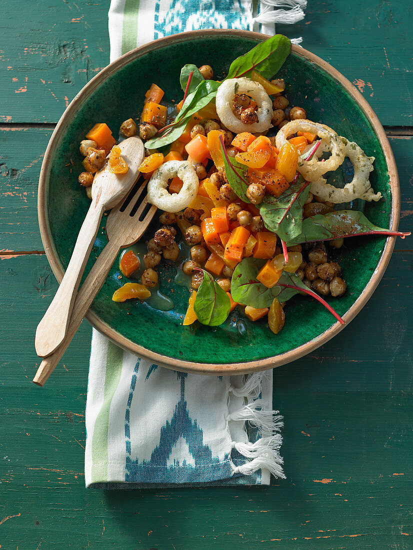 Chickpea salad with dried mango, chard leaves, carrots and roasted onions