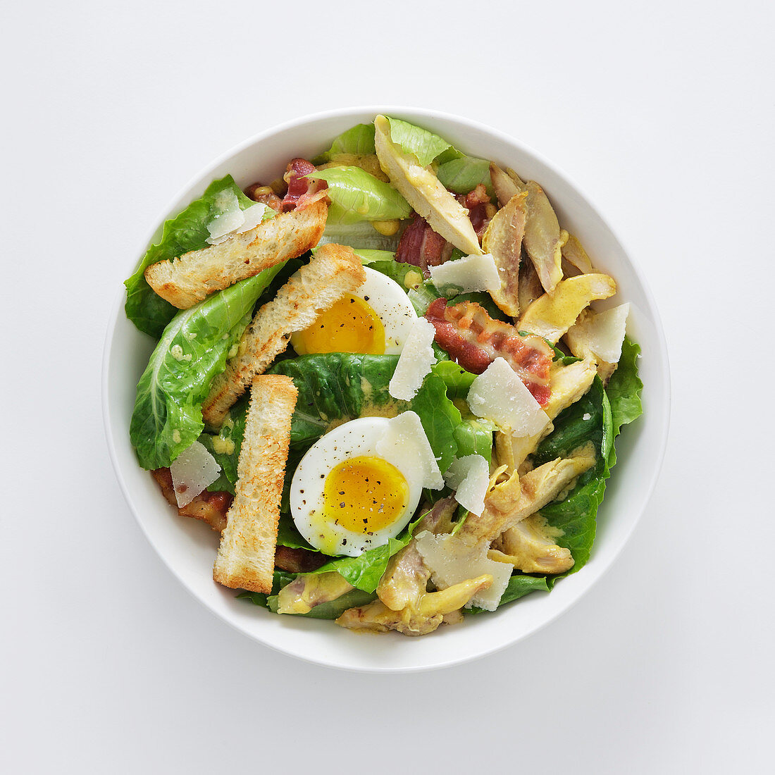 Caesar salad with bacon and soft-boiled egg