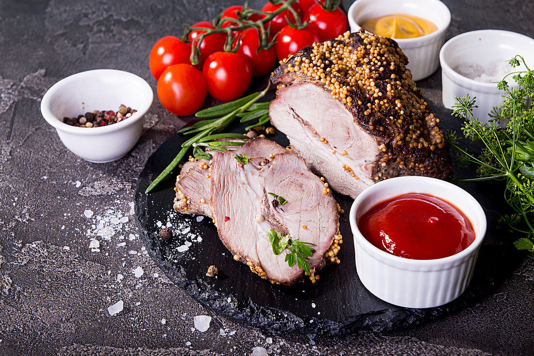 Cold-boiled pork garnish with cherry tomato, ketchup, mustard