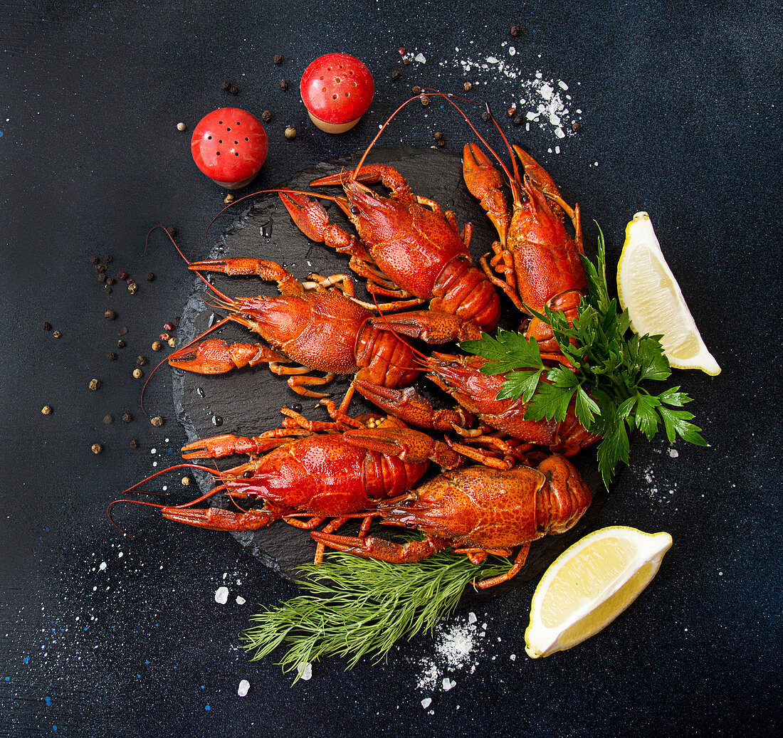 Boiled cooked crayfish crawfish ready to eat on white cutting board