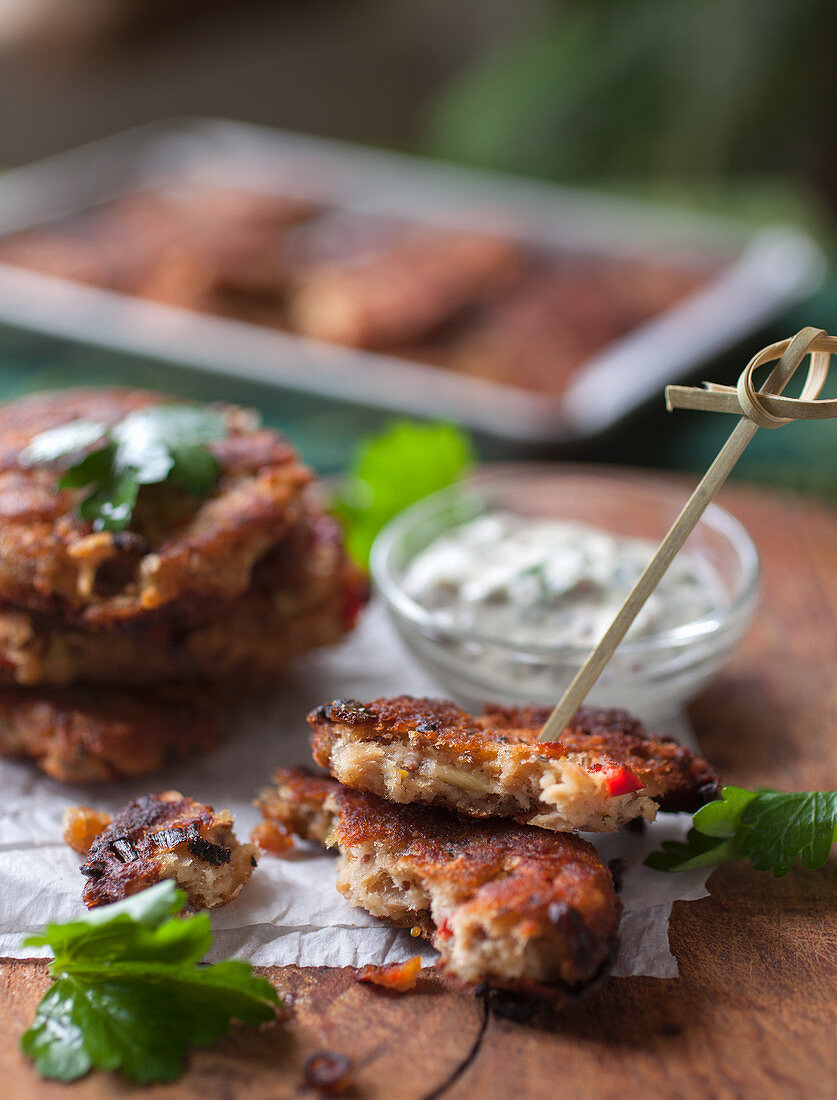 Stacked Salmon Croquettes on Wod Cutting Board with Dill Mayo