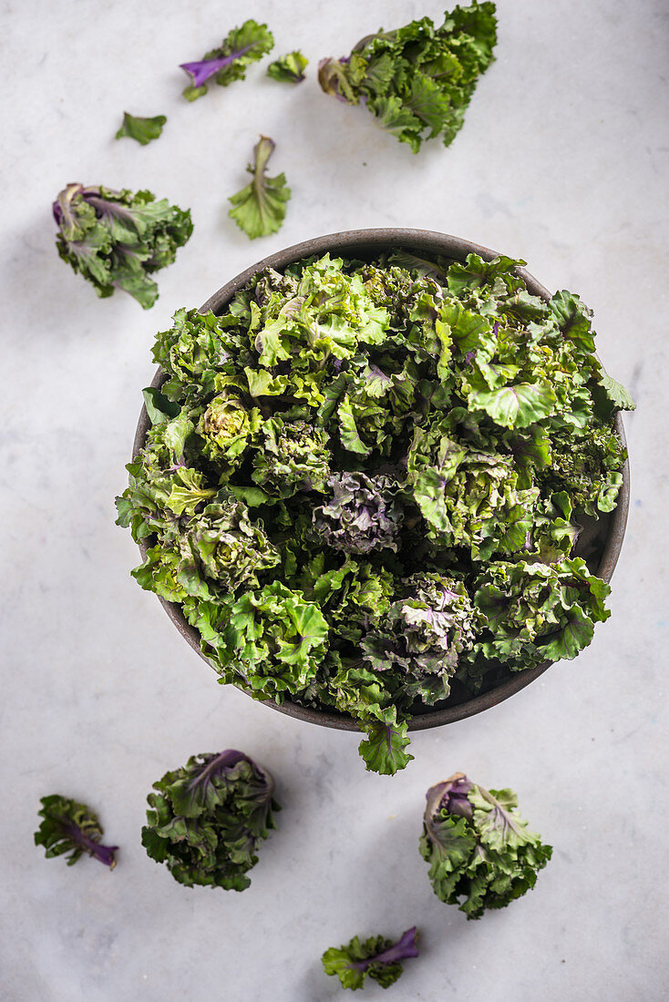 Kalettes on a Marble Top