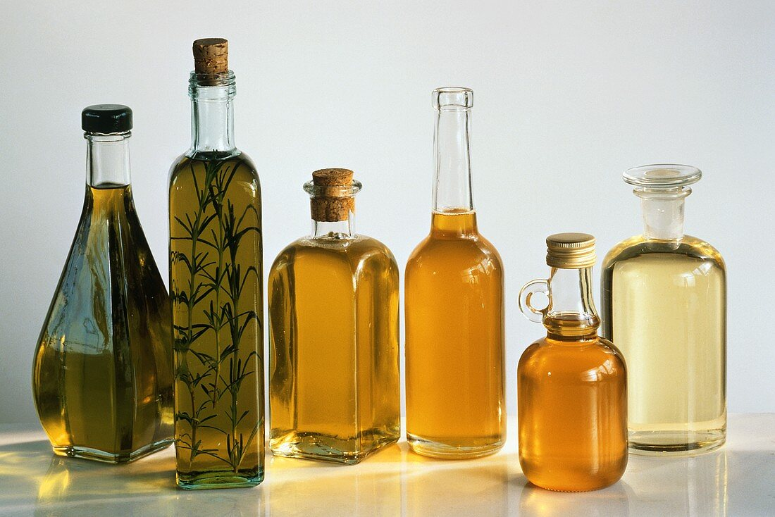 Many Assorted Oils in Glass Bottles