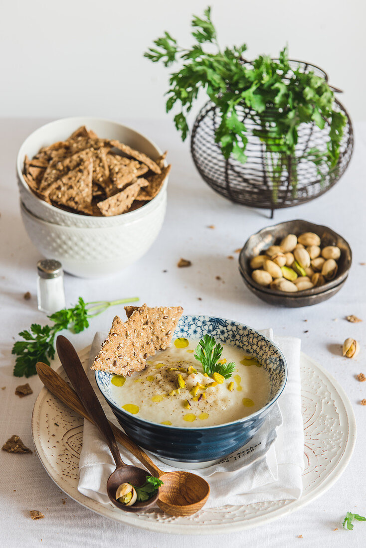 Parsley root and pear soup with pistachio
