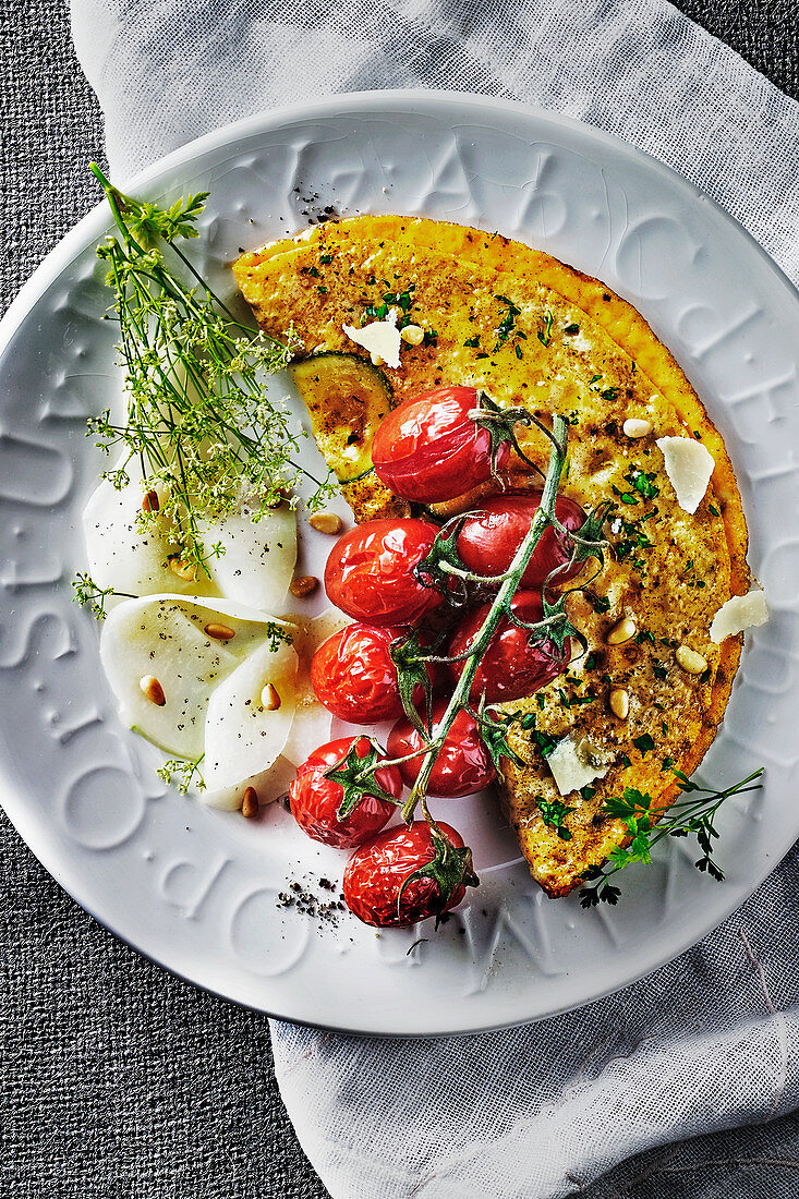 Courgette omlette with herbs, tomatoes, kohlrabi carpaccio and dill flowers
