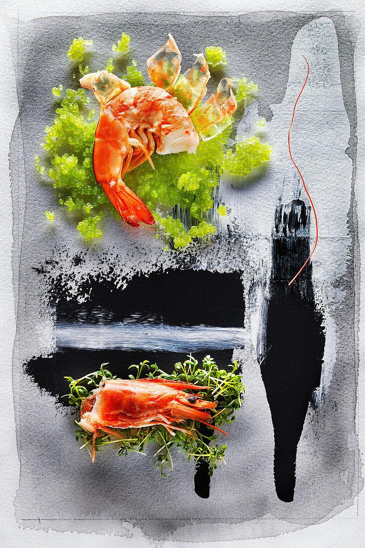 Food art: punk shrimp on wasabi caviar and cress