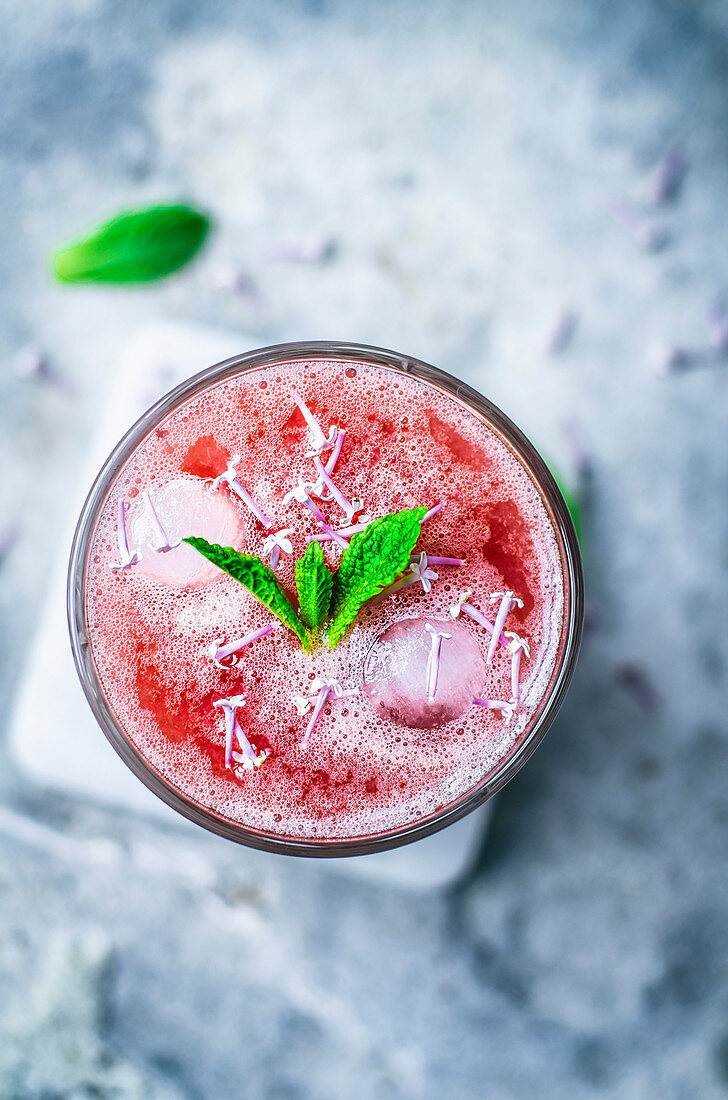 Pink lemonade with mint and lilac blossoms