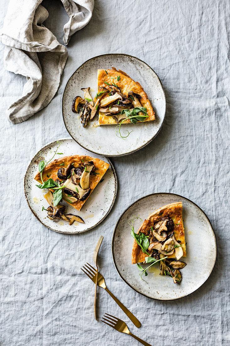 Wild Mushroom Savory Dutch Baby pancake with Pea Greens