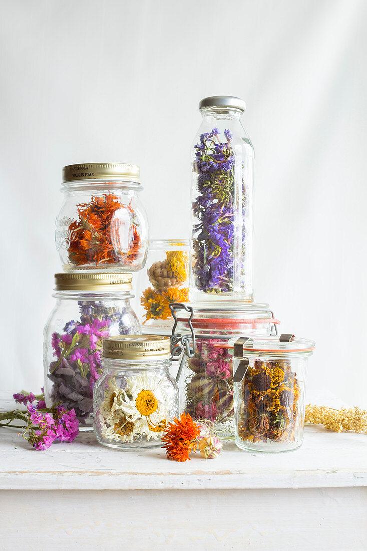 Dried flowers in screw-top jars and preserving jars