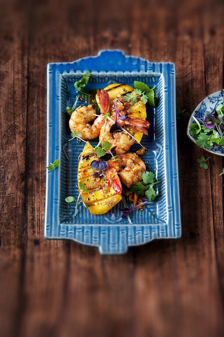 Warm marinated king prawns with grilled mango
