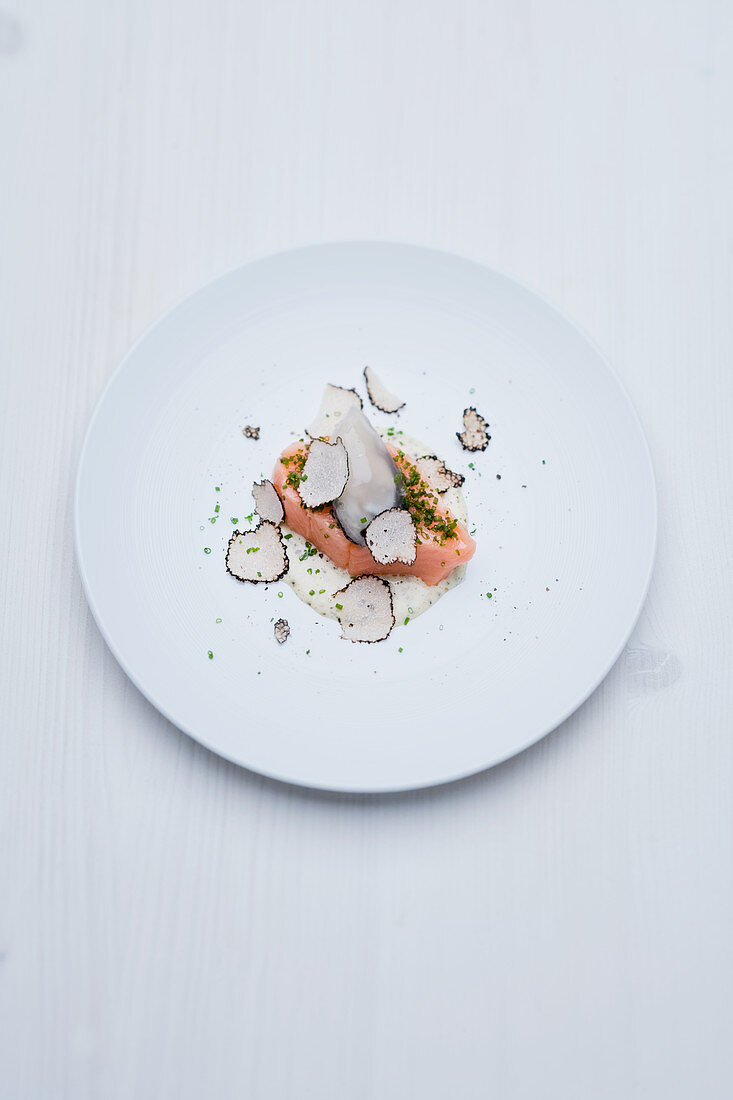 Salmon fillet sous vide and poached oysters with champagne-truffle aioli and summer truffles