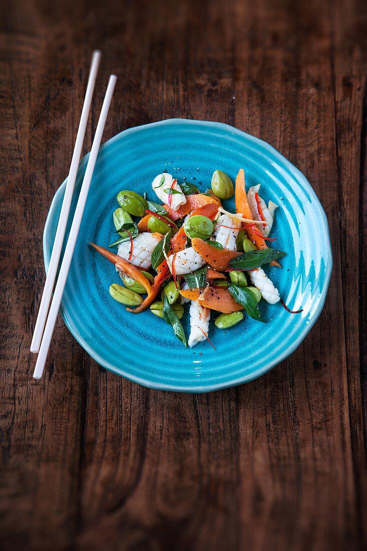 A green bean, papaya and squid salad with Thai basil