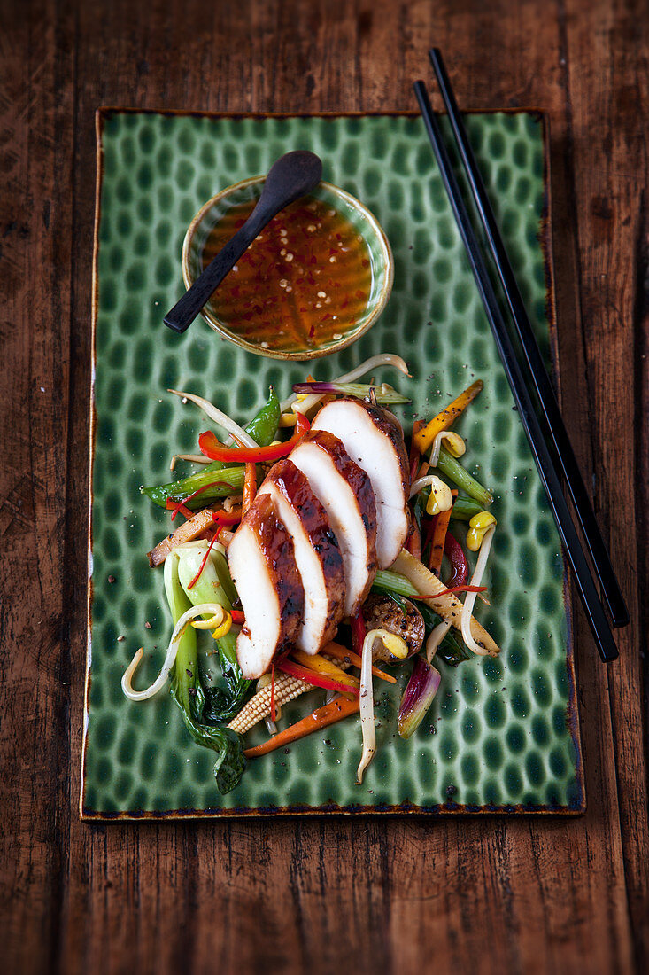 Marinated chicken breast with colourful stir-fried vegetables