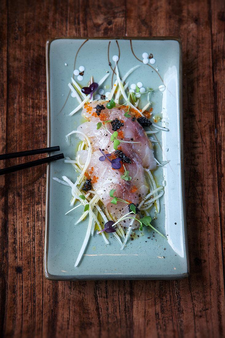 Barramundi sashimi on sweet-and-sour radish