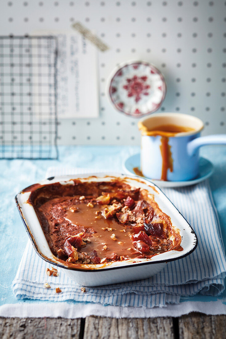 Date and nut pudding with toffee sauce (England)