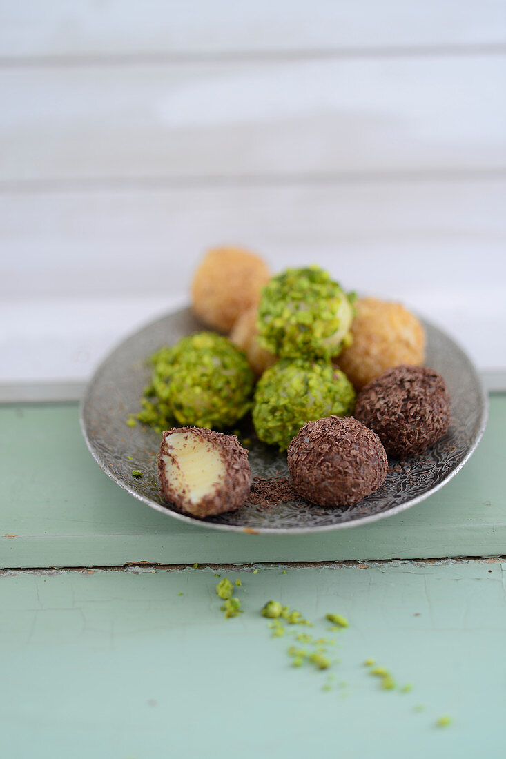 Brigadeiros (truffle pralines, Brazi) with pistachios and chocolate