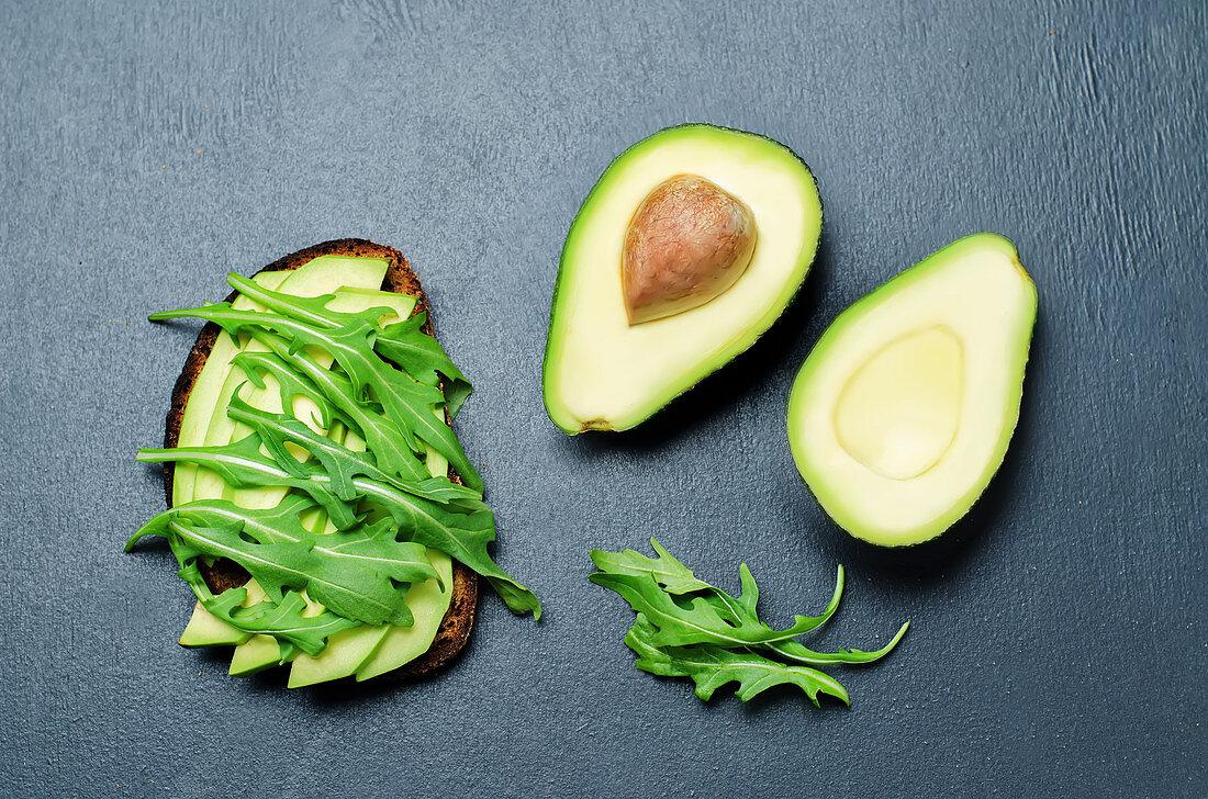 Rye breakfast sandwich with arugula and avocado