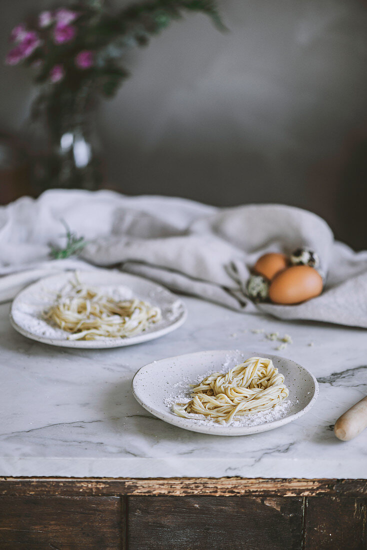 Raw pasta on marble background