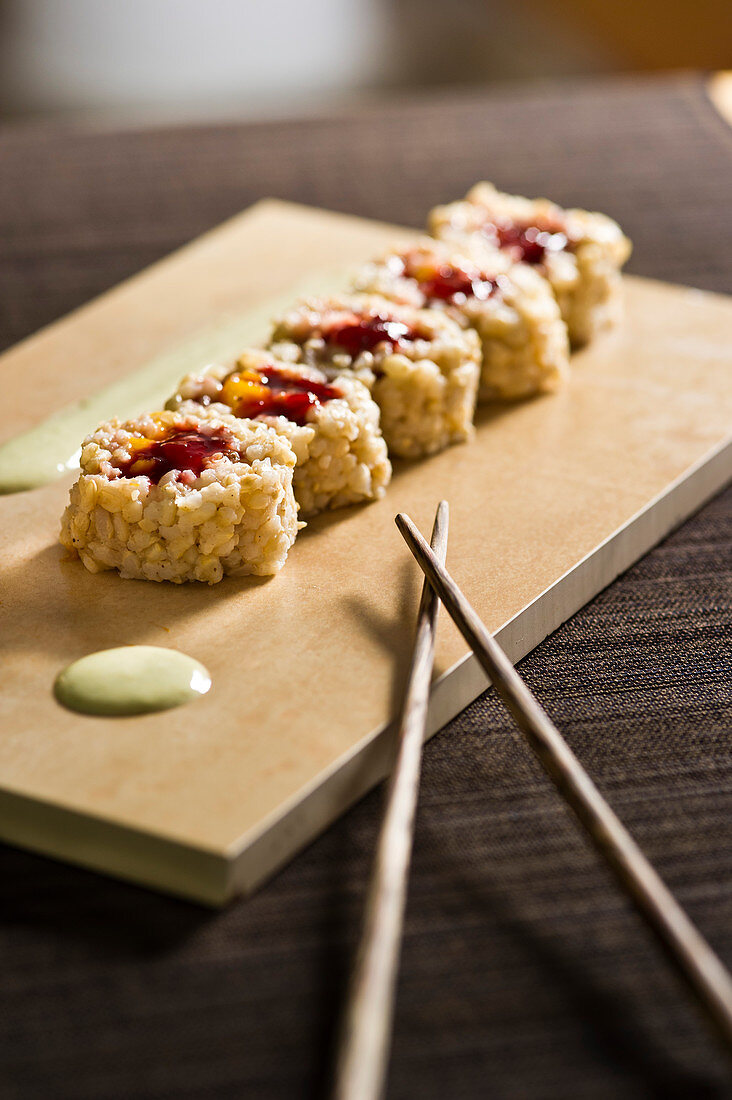 Sweet makis with rice, cardamom and almond paste with a fruity filling