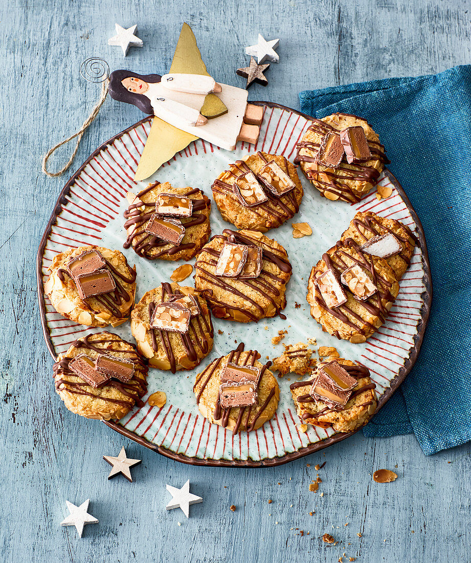 Christmas almond biscuits decorated with chocolate bar chunks