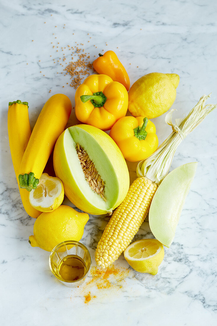 An arrangement of yellow foods (seen from above)