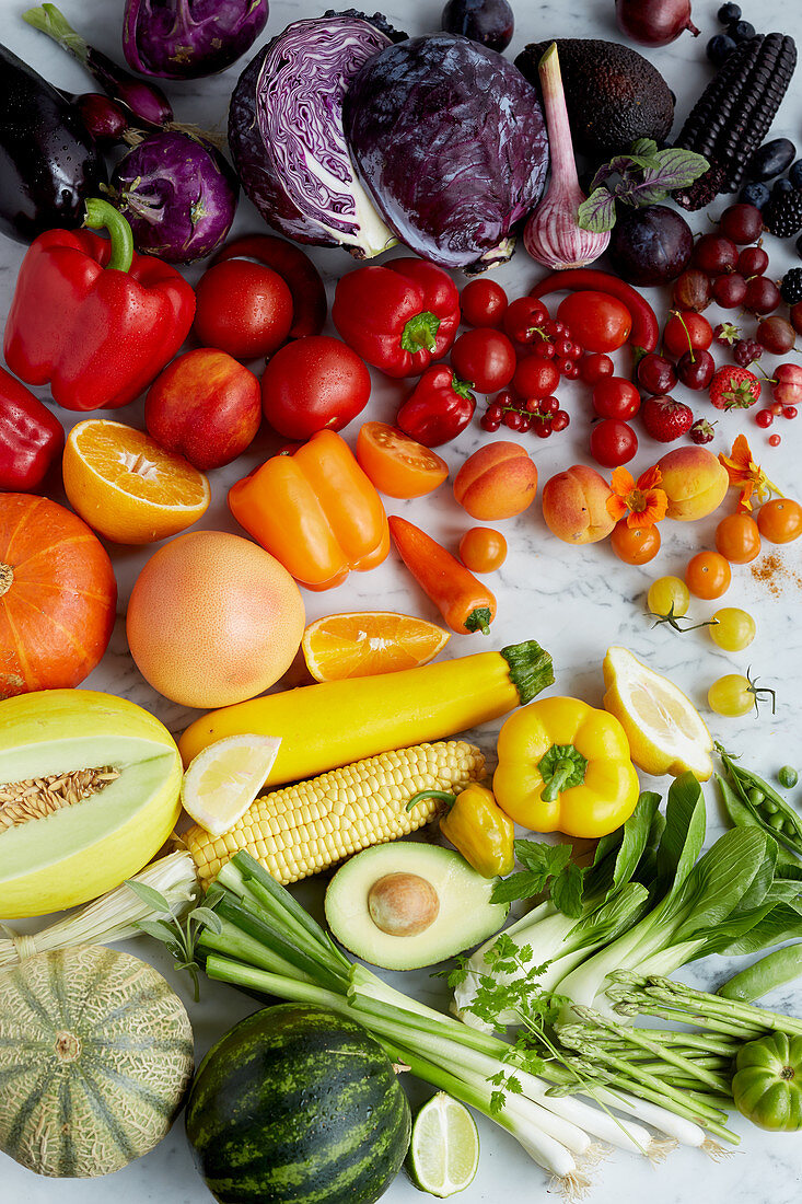 Fresh fruit and vegetables arranged in a colour gradient