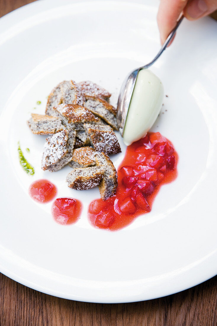 Poppy seed pancakes with coconut ice cream and marinated strawberries