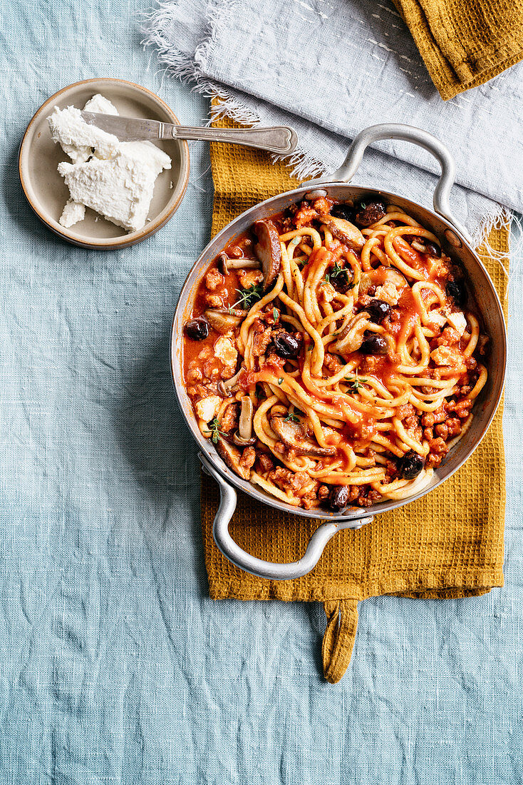 Spaghetti with wild mushrooms, meat sauce and ricotta