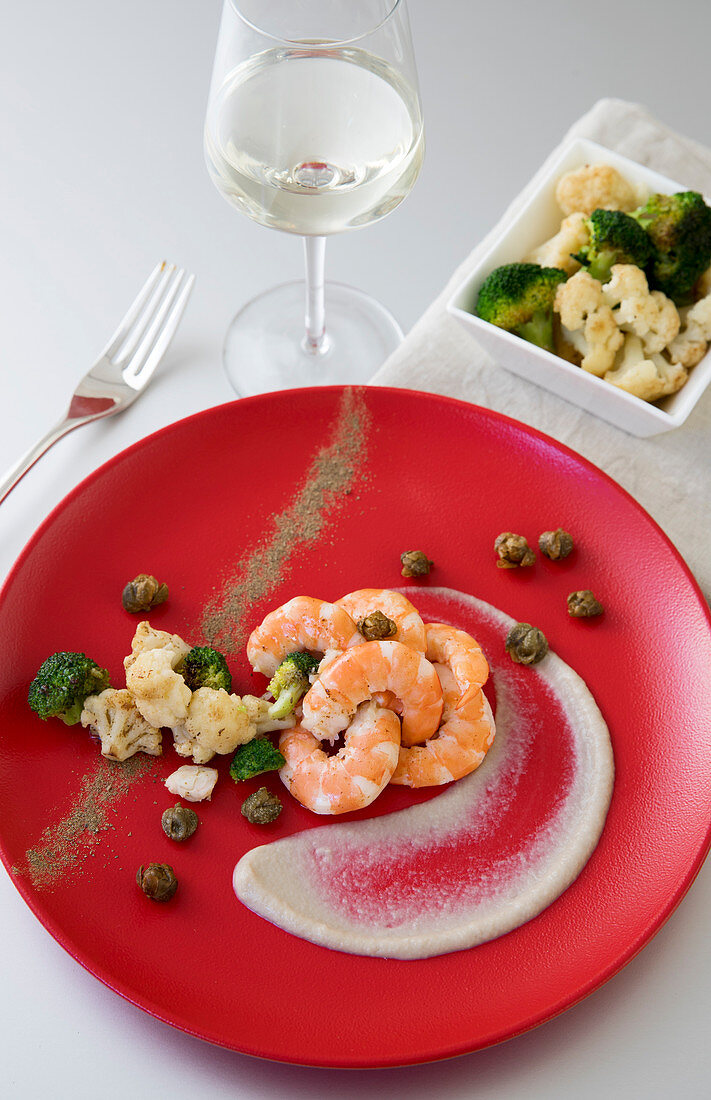 Sautéed prawns, cauliflower and broccoli florets with cauliflower and anchovy sauce and fried capers