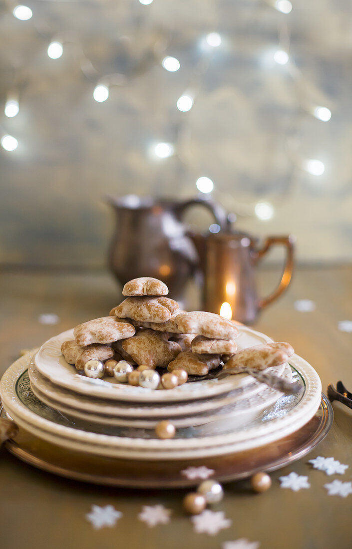 Plate of gingerbread biscuits with Christmas decorations