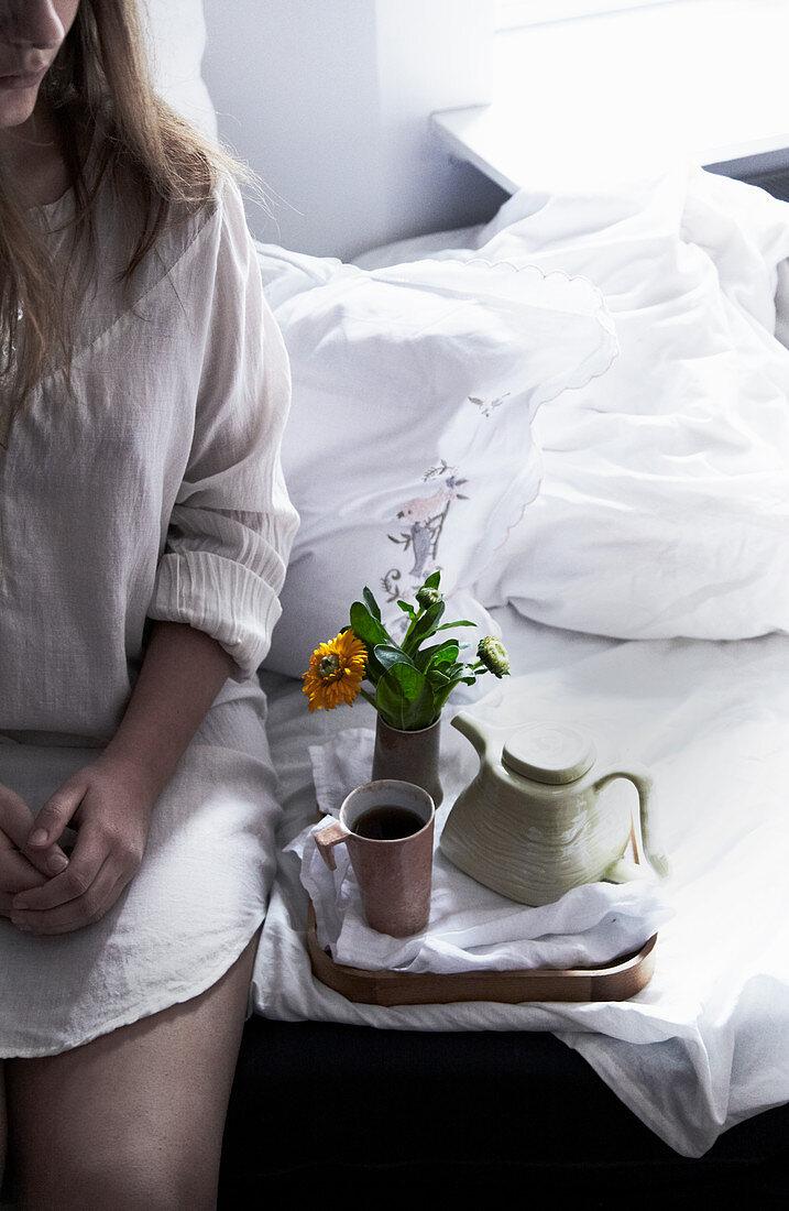 Woman having breakfast in bed