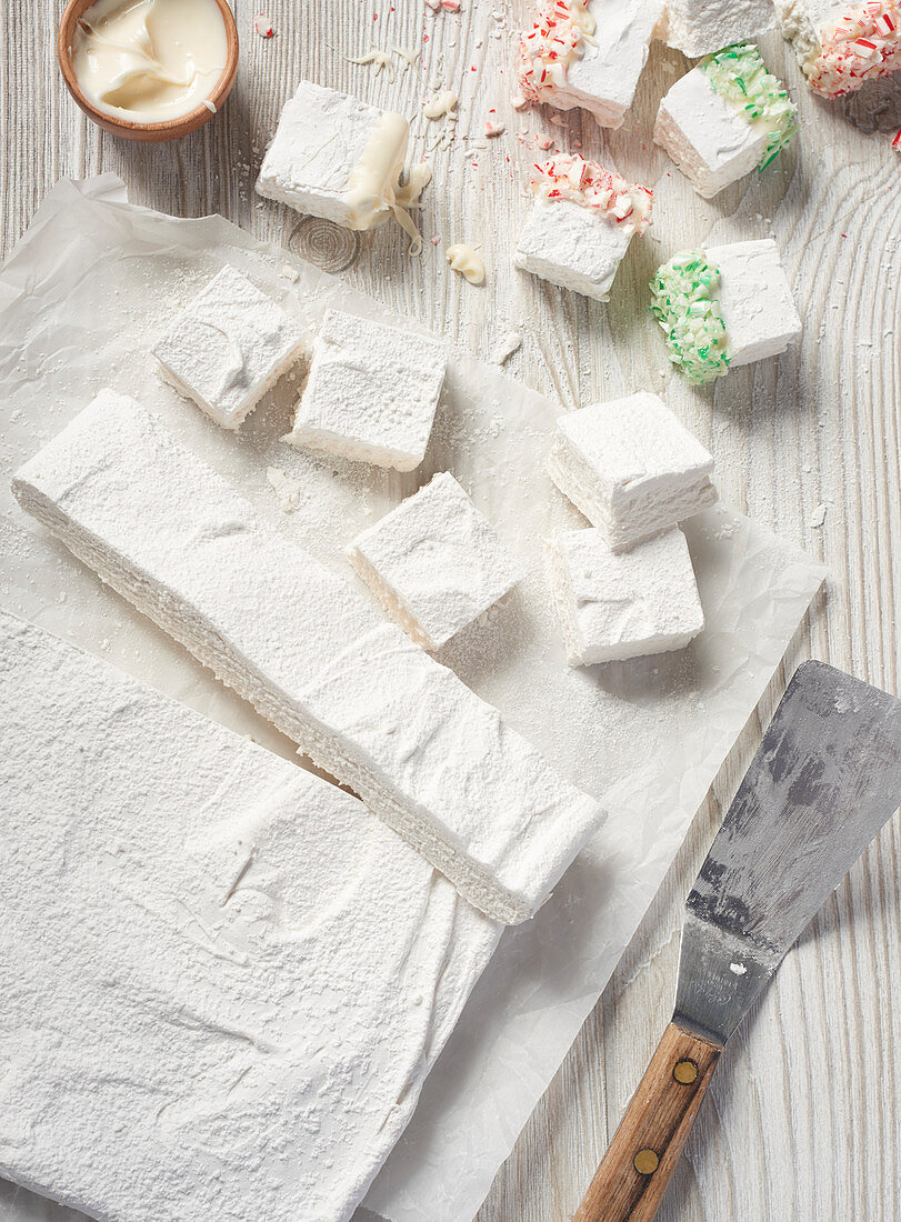 Homemade marshmallows with white chocolate and sugar sprinkles