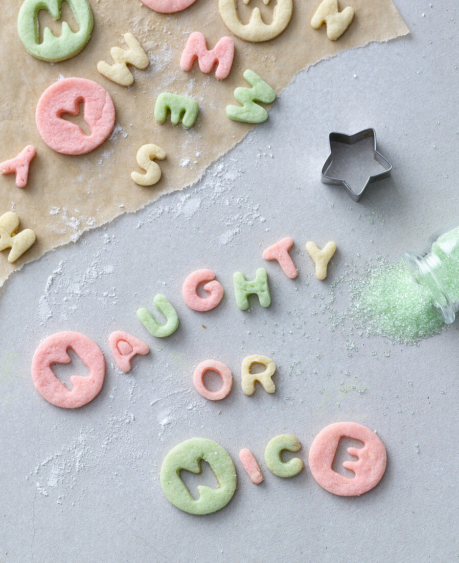 The words 'Naughty or Nice' cut out of colourful pastry